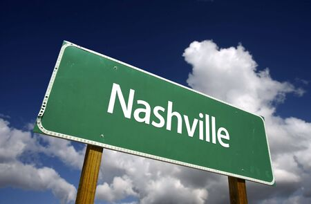 tennessee: Nashville Road Sign with dramatic blue sky and clouds - U.S. State Capitals Series.