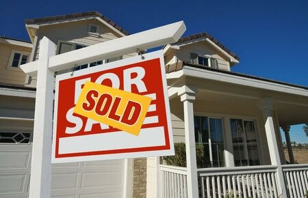 Sold Home For Sale Sign in Front of Beautiful New House. Stock Photo - 5777710