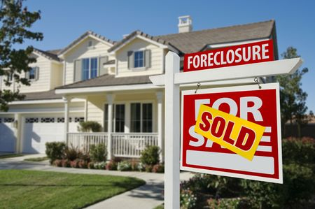 foreclosure: Sold Foreclosure Home For Sale Sign in Front of Beautiful House. Stock Photo