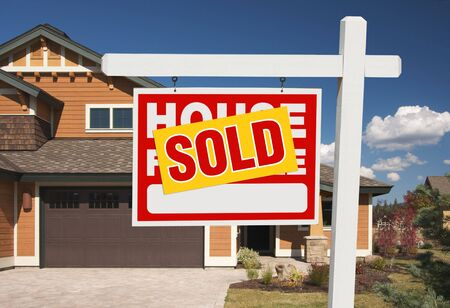 Sold Home For Sale Sign in Front of Beautiful New House. Stock Photo - 5853540