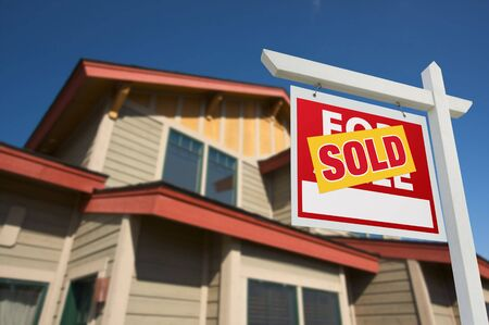 Sold Home For Sale Sign in Front of Beautiful New House. Stock Photo - 5853538