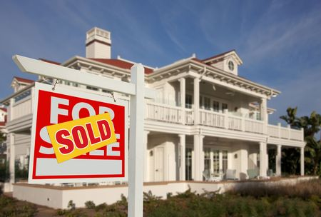 Sold Home For Sale Sign in Front of Beautiful New House. Stock Photo - 5853543