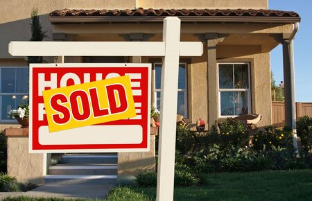 Sold Home For Sale Sign in Front of Beautiful New House. Stock Photo - 5853555
