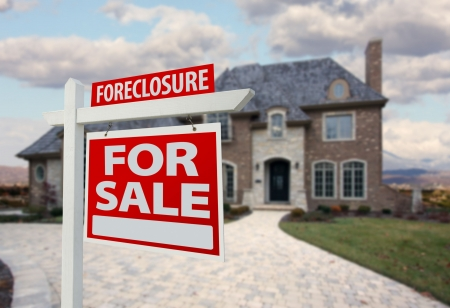 foreclose: Foreclosure Home For Sale Sign and House with Dramatic Sky Background. Stock Photo