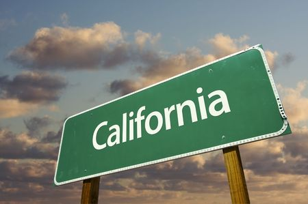 California Green Road Sign with dramatic blue sky and clouds. photo