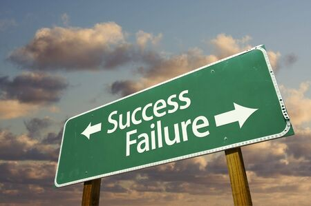 Success and Failure Green Road Sign with dramatic blue sky and clouds. Stock Photo - 5848637