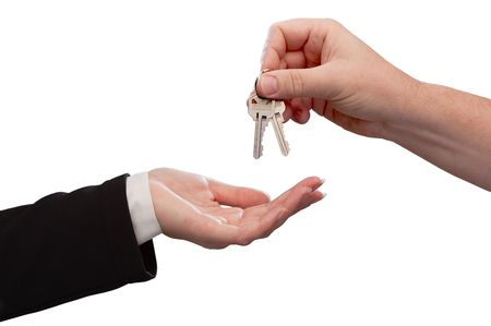Man Handing Over Woman Set of Keys Isoltaed on a White Background. Stock Photo - 5883687