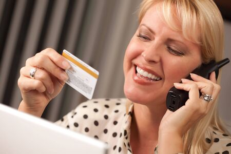 Beautiful Woman on the Phone Holding Her Credit Card. Stock Photo - 5925077