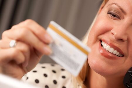 Beautiful Woman on the Phone Holding Her Credit Card. Stock Photo - 5925070