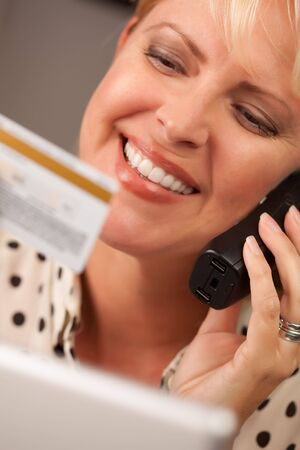 Beautiful Woman on the Phone Holding Her Credit Card. Stock Photo - 5925068