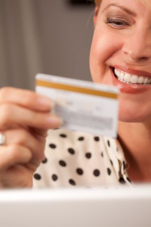 Beautiful Woman on Her Laptop Holding Her Credit Card. Stock Photo - 5925071