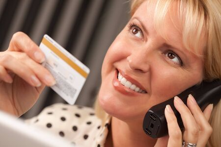 Beautiful Woman on the Phone Holding Her Credit Card. Stock Photo - 5925075