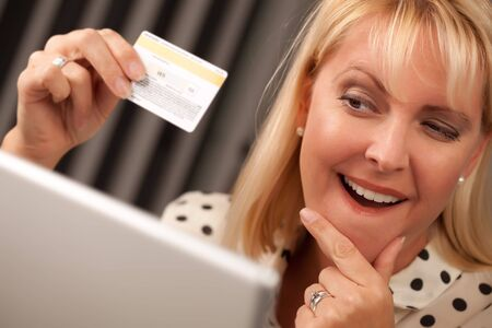 Beautiful Woman on Her Laptop Holding Her Credit Card. Stock Photo - 5925078