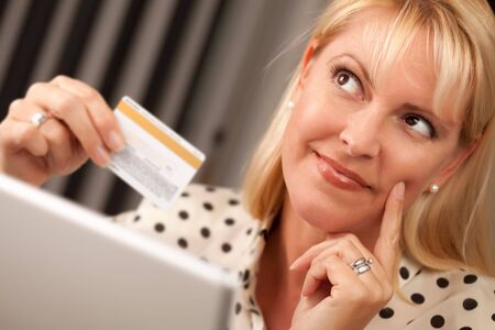 Beautiful Woman on Her Laptop Holding Her Credit Card. photo