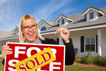 homebuyer: Beautiful Female Holding Keys to a New House & Sold Real Estate Sign.