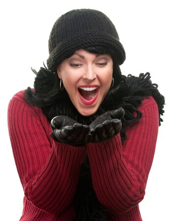 Excited Woman In Winter Clothes Holds Her Hands Out Isolated on a White Background. Stok Fotoğraf