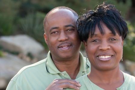 Attractive and Affectionate African American Couple posing in the park. photo