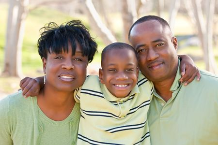 two generation family: Happy African American Man, Woman and Child Having Fun in the Park.
