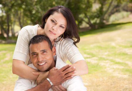 mid twenties: Attractive Hispanic Couple Portrait in the Park. Stock Photo