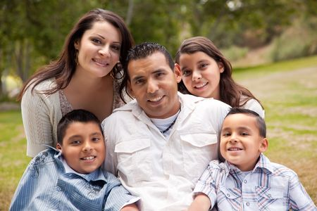 Happy Hispanic Family Portrait In the Park. photo