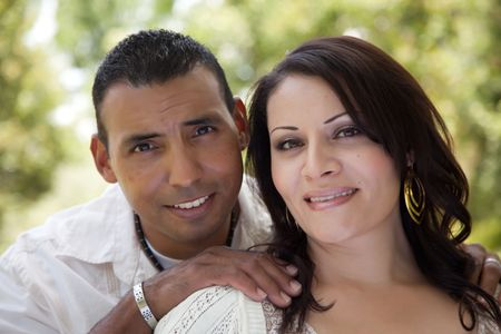 middle age man: Attractive Hispanic Couple Portrait in the Park. Stock Photo