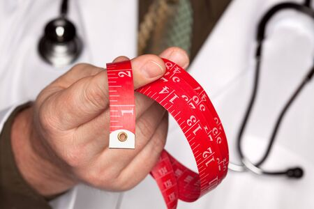 metric: Doctor with Stethoscope Holding Red Measuring Tape.