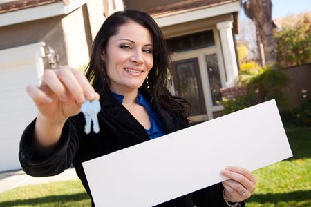 homebuyer: Happy Attractive Hispanic Woman Holding Blank Sign and Keys in Front of House.