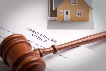 bank owned: Foreclosure Notice, Gavel and Model Home with Selective Focus.