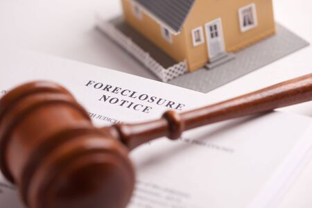 Foreclosure Notice, Gavel and Model Home with Selective Focus. photo