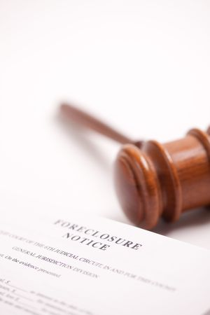 bank owned: Foreclosure Notice and Gavel on Gradated Background with Selective Focus.