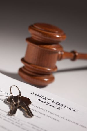 housing problems: Foreclosure Notice, Gavel and House Keys on Gradated Background with Selective Focus.