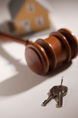 bank owned: Gavel, House Keys and Model Home on Gradated Background with Selective Focus. Stock Photo