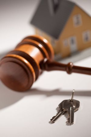 owned: Gavel, House Keys and Model Home on Gradated Background with Selective Focus. Stock Photo