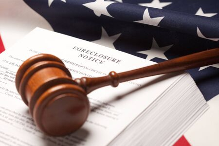 housing problems: Gavel, American Flag and Foreclosure Notice with Selective Focus.