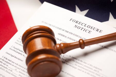 Gavel, American Flag and Foreclosure Notice with Selective Focus. photo