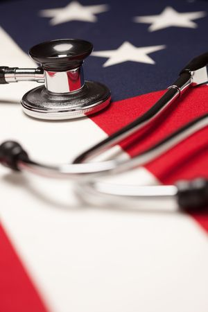 stethoscope: Stethoscope on American Flag with Selective Focus. Stock Photo