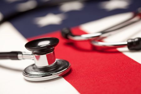 Stethoscope on American Flag with Selective Focus. Stock Photo