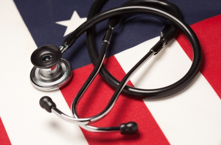 health reform: Stethoscope on American Flag with Selective Focus. Stock Photo