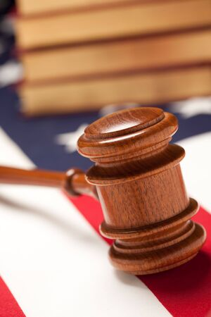 Gavel and Books on the American Flag with Selective Focus. Imagens