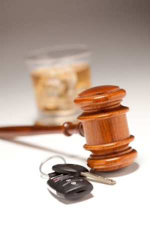 Gavel, Alcoholic Drink & Car Keys on a Gradated Background - Drinking and Driving Concept.