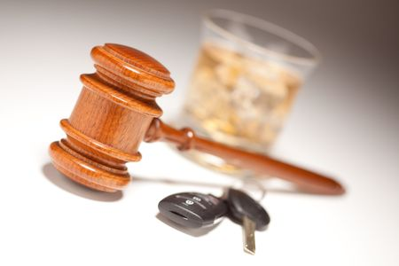 inebriated: Gavel, Alcoholic Drink & Car Keys on a Gradated Background - Drinking and Driving Concept.