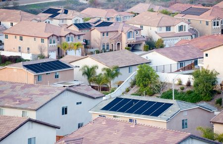 Contemporary Neighborhood Roof Tops View with Solar Panels. photo