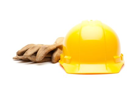Yellow Hard Hat and Gloves Isolated on White. Stock Photo