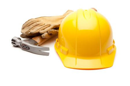 Yellow Hard Hat, Gloves and Hammer Isolated on White.