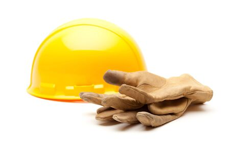 Yellow Hard Hat and Gloves Isolated on White. Stock Photo - 6394868
