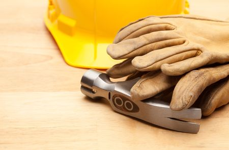 Yellow Hard Hat, Gloves and Hammer on Wood Surface. Stock Photo - 6394872