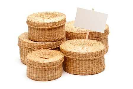 Various Sized Wicker Baskets with Blank Sign Isolated on White. photo
