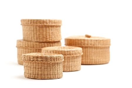Stack of Various Sized Wicker Baskets Isolated on White. photo