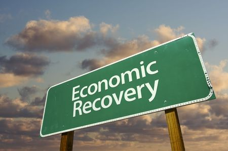 Economic Recovery Green Road Sign with dramatic clouds and sky. Stock Photo - 6394891