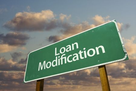 Loan Modification Green Road Sign with dramatic clouds and sky. Stock Photo - 6394895